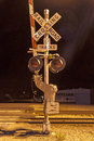 Railroad crossing sign by night Royalty Free Stock Photo