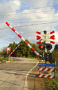 Railroad crossing on a winding road Royalty Free Stock Images