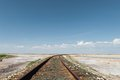 Railroad in desert under blue sky Stock Photo
