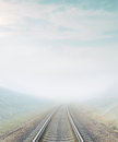 Railroad go to horizon in fog Royalty Free Stock Photo