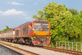 Railroad locomotive traveling in thailand Stock Images