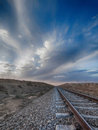 Railroad passing through the desert area Stock Image