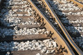 Railroad rails sleepers and gravel iron old closeup Stock Photo