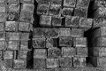 Railroad Ties Stacked in Black and White Royalty Free Stock Images