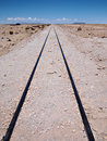 Railroad track leading nowhere far away in the distance in the desert at the train graveyard of uyuni in bolivia Stock Image