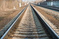 Railroad track in spring with shallow focus Royalty Free Stock Photography
