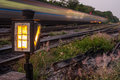 Railroad track warning light train passing background Royalty Free Stock Image