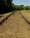 Railroad tracks arriving at the station Stock Photo