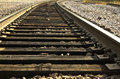 Railroad tracks closeup view of curving off into the distance Royalty Free Stock Photo