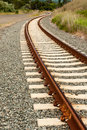 Railroad tracks curve into the distance Royalty Free Stock Photo