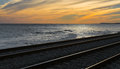 Railroad tracks at sunset overview of a Royalty Free Stock Photos