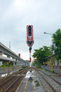 Railroad with traffic light after raining Stock Photos