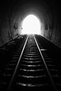 Railroad tunnel light at the end of natural lighting Royalty Free Stock Photos