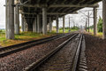 Railroad under highway bridge Royalty Free Stock Photo