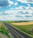 Railroads to horizon and cloudy sky Royalty Free Stock Images