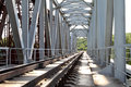 Rails of the railway way which are passing through bridge Stock Photo