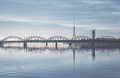 Railway bridge over the daugava river riga latvia Stock Photo
