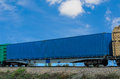 Railway container on the wagon platform Royalty Free Stock Photos