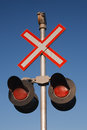 Railway crossing sign and blue sky Royalty Free Stock Photography