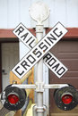 Railway crossing sign vintage with red flashing Royalty Free Stock Photos