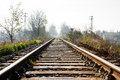 Railway for local trains railroad tracks across rural countryside in slovakia Royalty Free Stock Photos