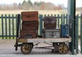 Railway luggage trolley vintage cases on a traditional Stock Photography