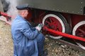 Railway maintenance bytom poland september enthusiast fixes old narrow gauge steam train on september in bytom poland in september Royalty Free Stock Images