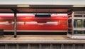 Railway platform with high speed red passenger train Royalty Free Stock Photo