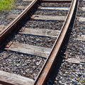 Railway rail road track disappearing around a curve Royalty Free Stock Photo