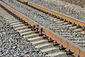 Railway rails and concrete sleepers closeup arrow rail Royalty Free Stock Photos