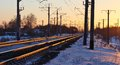 The railway in the rays of sunset frosty evening sun light stretching into distance rails Stock Photos