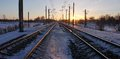 The railway in the rays of sunset frosty evening sun light stretching into distance rails Stock Image