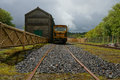 Railway siding train carriage standing at a disused train tracks create lead in line taken at meldon on dartmoor in the uk Royalty Free Stock Image