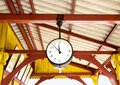 Railway station clock hanging onto the roof of the old train sta Royalty Free Stock Photo