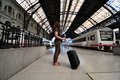 Railway station girl standing on a platform of a Royalty Free Stock Photo