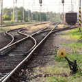 Railway station railroad track with trains freight cars Royalty Free Stock Photography