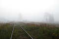 Railway to horizon in fog Royalty Free Stock Photo