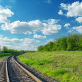 Railway to horizon in green landscape Royalty Free Stock Photo