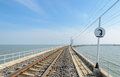 Railway track lead across the lake in thailand Royalty Free Stock Photo