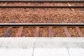 Railway track and platform local background view from Royalty Free Stock Image