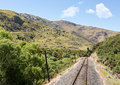 Railway track up taieri gorge new zealand of tourist passes zigzag road on its journey the valley Royalty Free Stock Images