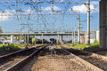 Railway track urban with confusing lines and overhead cables Royalty Free Stock Image