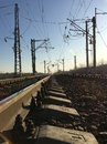 Railway tracks and electric lines in the industrial zone. Nature. Royalty Free Stock Photo