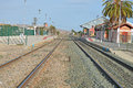 Railway - Empty Tracks And Station Royalty Free Stock Photo