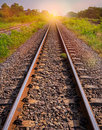 Railway tracks in sun raise moment with flair of sun Royalty Free Stock Photo
