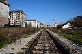 Railway tracks weathered apartment buildings and red industrial chimney Belgrade Serbia Royalty Free Stock Photo