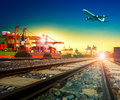 Railway transport in import export shipping port and cargo plane logistic flying above use as freight transportation business Stock Images