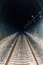 Railway in tunnel through the mountains Royalty Free Stock Photo