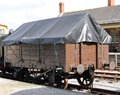 Railway wagon a vintage with a tarpaulin cover Stock Photos
