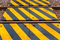 Railway and the warning sign in Thailand Royalty Free Stock Photo